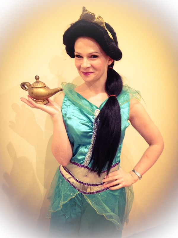A lady dressed as Princess Jasmine holding a genie lamp