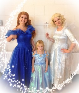 Blue ball gown Cinderella entertainer and her Fairy Godmother with a little girl