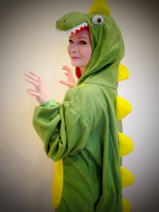 Lady dressed in a dinosaur onesie at Spellbound Parties